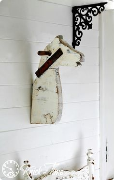 Here's a fun way to give new life to an old, rundown rocking horse: Turn it into unique a piece of wall decor!!