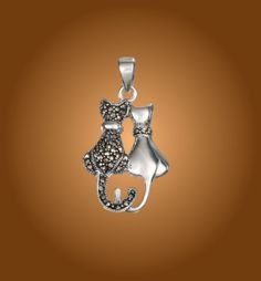 Sterling Silver Sitting Kitties Pendant. https://www.wekittycats.com/collections/jewelry/products/sterling-silver-sitting-kitties-pendant