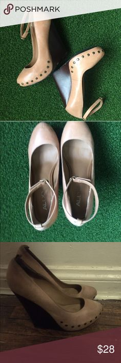 Aldo wedge heel Leather wedge heel tan color says 39 on the bottom but I'm pretty sure it's a 8.5 Aldo Shoes Wedges