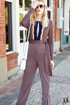 Embrace street style in a sophisticated silk striped jumpsuit by Diane von Furstenberg. Wrap and style to your heart's content.