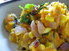 http://byebyegluten.blogspot.com/2008/09/roasted-butternut-squash-with-corn.html?m=1 Roasted Butternut Squash with Corn  1 2 lb. butternut squash, peeled 1 large red onion, chopped (about 1.5 cups) 4 Tbsp olive oil 1 tsp garlic peri-peri sauce 1 tsp wild-herb peri-peri sauce 1 Tbsp sea salt 1.5 cups frozen corn (roasted if you like) or 1 cup fresh 1/8 tsp cayenne 1/4 cup organic dried cranberries 1/2 cup chopped organic cilantro