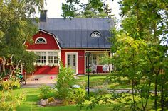 Looks like the house in Sweden my Grandmother grew up in...still in the family. I will definitely see it in person one day!