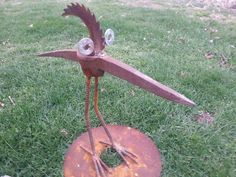 pick bird.  rusty relics metal art