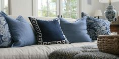 colour trend for 2017 denim blue cushions on white sofa in front of patio windows