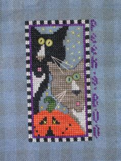 Peek A Boo is the title of this fun cross stitch pattern from Val's Stuff.