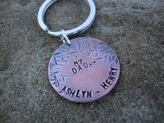 Daddy's Hug Hand Stamped Textured Oxidized Copper Disc Key Ring. $20.00, via Etsy.