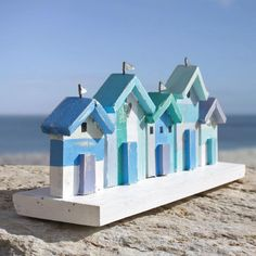 Capture the mood and set the scene with this charming and colourful beach hut frieze The quirky blue and aqua coloured huts are full of coastal style.