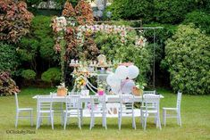 Your heart is sure to bloom over this Birthday Garden Party by Raidha Mulafer of Impressions, out of Colombo, Sri Lanka! ...From the sweet garden decor to the enchanting treats, this first birthday celebration you'll want to view on repeat! So fill your watering can and be sure to pour over these details I'm certain will be adored:  Garden Box Table Centerpieces Adorable Garden Themed Sugar Cookies on Mini Easels Custom Garden-inspired Candy Bar Labels White Guest Table with coordinating White C