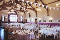 Village hall decorated for a pretty handmade wedding | Photography by http://racheljoycephotography.com/