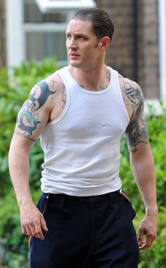 Tom Hardy, tattoos and wearing a wife beater...my idea of PERFECTION