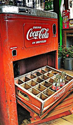 coca-cola machine: Oh what memories!! Country dirt roads w/dust blowing in big clouds behind the car. Little roadside gas stations/stores along the way. The coke machines sat on the porch of the store and you reached into elbow-deep melted ice water to grab your coke of grapette!! Coldest, best soft drinks in the world!!