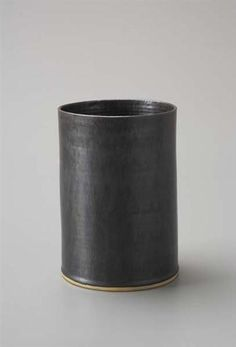 LUCIE RIE  Cylindrical vase, ca. 1960  Stoneware, manganese glaze.  Underside impressed with artist's seal.  8 1/4 in. (21 cm) high