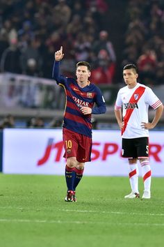 Lionel Messi of FC Barcelona celebrates after scoring a opening goal during the final match between River Plate.and FC Barcelona at International Stadium Yokohama on December 20, 2015 in Yokohama, Japan.