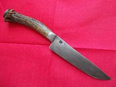 Hand forged primitive knife deer antler handle