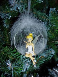 Shouldn't I be at the top of the tree? Hades Disney, Walt Disney, Tinkerbell And Friends, Tinkerbell Disney, Disney Christmas Ornaments, Pink Christmas, Tinkerbell Ornament, Tinkerbell Wallpaper, Globe Decor
