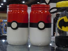 Gotta have them all! Pokeball style mason jars for Geek Decor! Great for organization, pen and pencil storage, a bank, Kids room decor, or for anything! Fun gift too! These are glass mason jars spray painted red and white. They have a black ribbon and polymer clay Poke-button on the front. Unique, handmade decor gift Can be used for organization or storage Fun Geek type Decor!  Can be a set or sold singly. The jars are the same size btw! Mason Jar Decor, Geek Decor, Pokemon Jar, Pokeball…