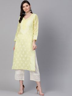 #Ada #handembroidered Lemon #Cotton #Lucknowi #Chikan Kurti-A100355 offers a comfortable and relaxed silhouette to the wearer, the fabric and embroidery is skin friendly  #Adachikan #handcrafted #chikankari #shoponline