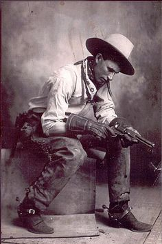 Choctaw Bill, Mora, NM; 1920's. Just look how he's dressed.  There is a very studied look about his attire, right town to the jingly-jangly spurs!