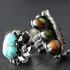 Flora and Fauna rings- size 6.5 vertabrae, size 8 triple green royston. Both entirely forged by hand in .925 Sterling silver. Both have wide birch bark textured shanks with banners. #turquoise #gypsy #boho #freepeople #freespirit #forest #woodland #fauna #flora #bohemian #jewelry #jewellery #designer #silversmith #banner #tattoo #tattoos #bone #bones #skull #skulls #skeleton #crystal #crystals