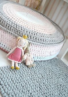 This marvelous and giant crochet cushion would be ideal for putting your feet up after a long day. Looks like the rug is crocheted too!