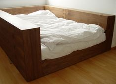 wood bed with white down comforter. My New Room, My Room, Spare Room, Sunken Bed, Enclosed Bed, White Down Comforter, Dark Bedding, White Bedding, Bedding Sets