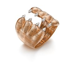 Tiger cuff, trillion diamonds and rose gold for a really strong personality