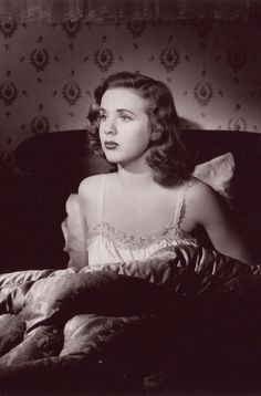 """Deanna Durbin in """"Christmas Holiday"""" (Robert Siodmak, 1944) - A young femme fatale-type woman (Deanna Durbin) realizes that the wealthy man (Gene Kelly) she married is a psychopath."""