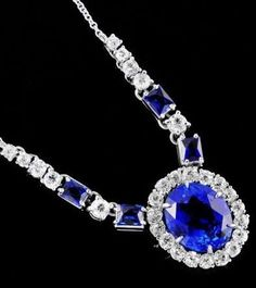 Art Deco Unheated Sapphire and Diamond Necklace. One antique ladies platinum necklace. The necklace features one claw-set large oval natural sapphire, approx. 9.25 carats, with a surround of 18 Old European-cut diamonds. The sapphire shows no evidence of heat treatment. The center arrangement hangs from two lines of alternating rectangular French-cut synthetic sapphires and graduated Old European-cut diamonds.