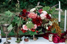 dramatic floral centerpiece - photo by Gina Paulson Photography http://ruffledblog.com/fall-calligraphy-wedding-inspiration