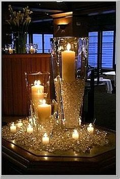 This candle centerpiece is actually pretty easy to put together. All you need is a few large white pillar candles, oversized candle holders, some votive candles, and lots and lots of glass or plastic faceted beads (plastic is cheaper, but glass will look nicer).