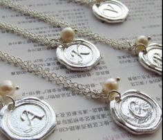 Free In't Shipping! A necklace with a letter sealed with silver and an unique pearl available from etsy.com