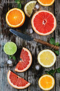 Photograph Sliced Citrus Fruits by Natasha Breen on 500px