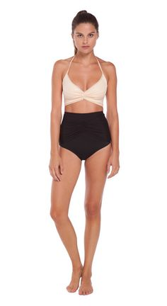 High waisted bottom with shirred mesh waist detail. Fully lined. Made in California. Color: Onyx (Black) Fabric: Nylon / Spandex