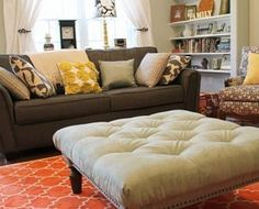 Emmeline, the DIY tufted ottoman, enjoying her new home in the living room.