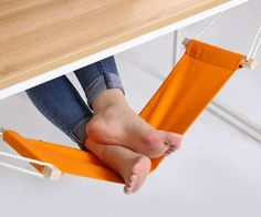 Dude I want that, http://www.dudeiwantthat.com/style/design/foot-hammock.asp