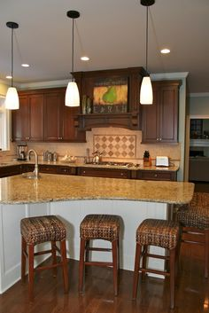 white island with moulding and dark cabinets