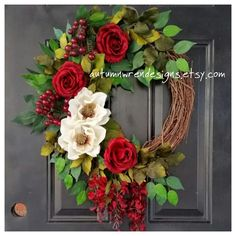 A beautiful mixture of cream magnolias and roses with mixed greenery and large red berries, this gorgeous wreath will be a show- stopper for everyone who walks by! Finished wreath measures approximately 20-22 in diameter.