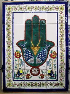 The Hand of Fatima, a protective sign popular in the Islamic world, appears on tiled panels sold at ceramic shops in Nabeul, Tunisia. Fatima, daughter of the Prophet Muhammad, is loved by all Muslims. Ceramic Shop, Hand Of Fatima, Carthage, Islamic World, Prophet Muhammad, Shops, Daughter, Kids Rugs, Sign