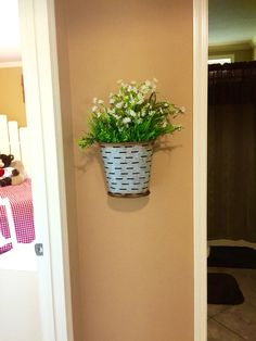 We just love an Olive Bucket and even more- one that hangs on the wall!
