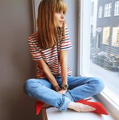 Pernille Teisbaek wears a striped t-shirt, cuffed jeans, and red pumps