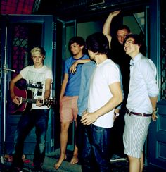 One Direction and Paul. I love how Louis is barefoot... And does Niall EVER go anywhere without his guitar?! They're cute!