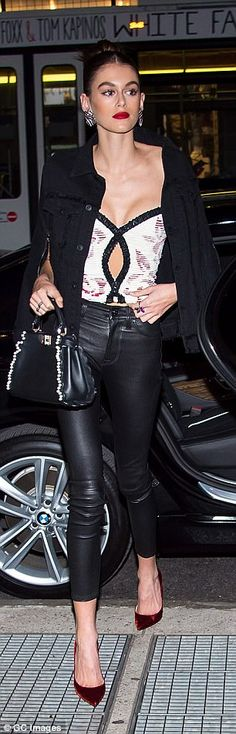 Heading to the event: Kaia rocked a beaded black handbag while going inside...