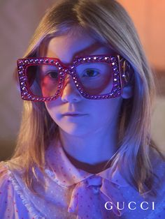 Hollywood Forever pink oversized squared sunglasses studded with hand-applied crystals, in an image shot byPetra Collinsfrom the newGucci Spring Summer 2017 film.