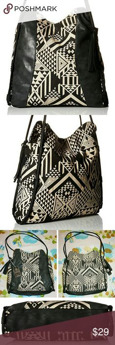 "Geometric Tribal Print Canvas & Leather Tote NWT I absolutely love this cute, boho bag! It's the perfect size, the faux leather on it is super soft, and the magnetic snap button to keep it closed is super convenient and holds nice and firm. It is fully lined and features both a zippered pocket and two unzippered pockets inside. It also comes with a detachable tassel. The materials are 50% polyurethane and 50% canvas. The dimensions are: 17"" shoulder drop, 13"" high, 13"" wide. Twig & Arrow…"