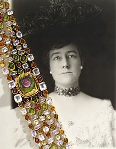 Gold and Colored Stone Choker, by Paulding Farnham. The collar composed of an openwork ground of collet-set variously-cut colored stones including faceted citrines, amethysts and topazes, and cabochon pink and green tourmalines, the central motif with a cabochon pink tourmaline atop a cabochon green tourmaline atop a faceted citrine platform; circa 1908. Provenance: made as a gift for Farnham's sister-in-law, Lucia James Madill.
