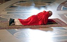 The Pope Francisco lies on the ground to mark the celebration of the Passion of Christ on Good Friday, in the basilica of St. Peter, Vatican City. (EFE)