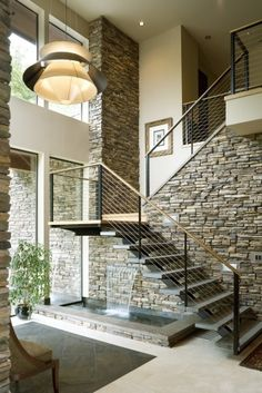 ~ Railing + stacked stone wall + understairs water feature +++ love this! #stair #design #water #feature
