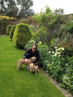 Butter and her two dogs, Wafer and Biscuit, spring in the garden