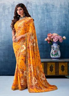 We offer wide range of party sarees collection with unique design patterns. Shop this faux georgette mustard printed saree. Floral Print Sarees, Printed Sarees, Trendy Sarees, Stylish Sarees, Latest Designer Sarees, Latest Sarees, Saree Sale, Celebrity Gowns, Indian Sarees Online