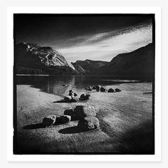 Boulders line the shore of Teneya Lake. Yosemite National Park, California 2012.Printed on Epson ...